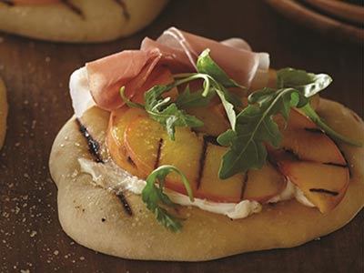 Pizza with Grilled Peaches and Prosciutto